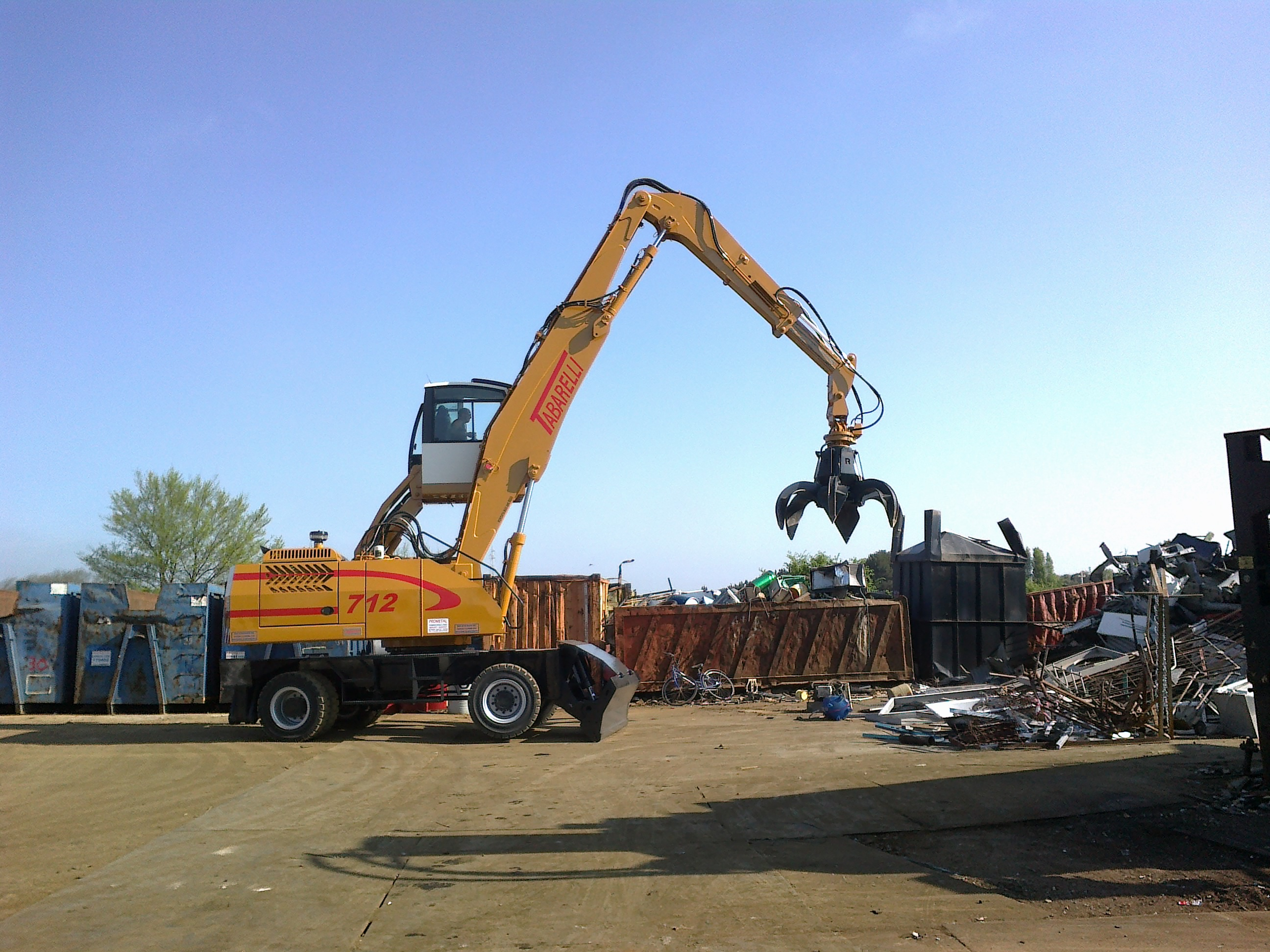 Tabarelli material handler T712 for scrap and waste loader crane
